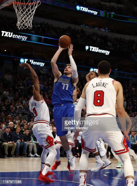 Luka Doncic of the Dallas Mavericks takes a shot against Shaquille Harrison of the Chicago Bulls at American Airlines Center on January 06 2020 in...