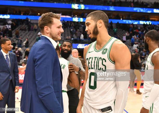 Luka Doncic of the Dallas Mavericks talks with Jayson Tatum of the Boston Celtics after the game on December 18 2019 at the American Airlines Center...