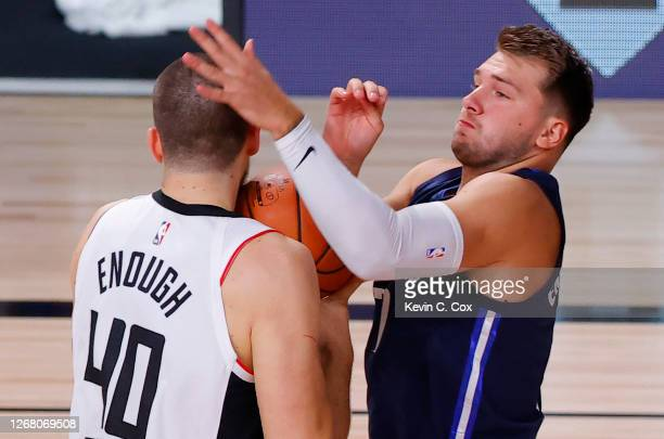 Luka Doncic of the Dallas Mavericks tangles with Ivica Zubac of the LA Clippers in Game Four of the Western Conference First Round during the 2020...