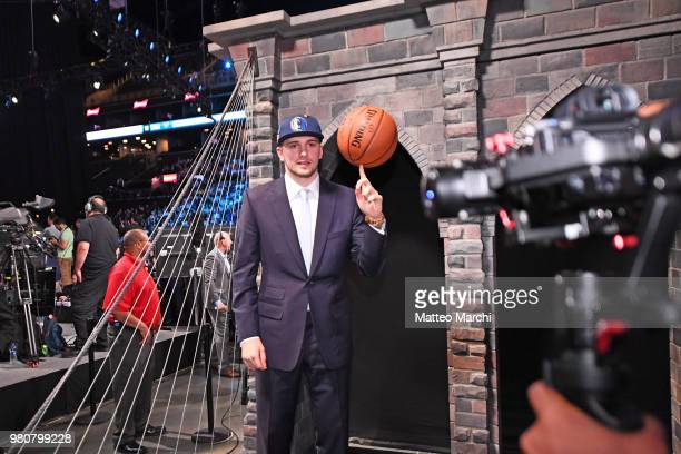 Luka Doncic poses for a photograph after being selected number three overall during the 2018 2018 NBA Draft on June 21 2018 in Brooklyn NY NOTE TO...