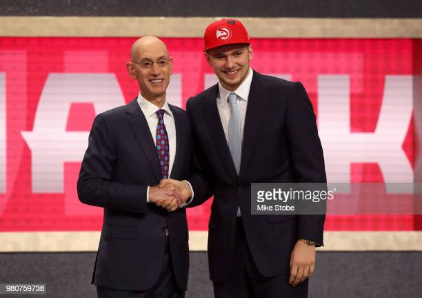 Luka Doncic poses with NBA Commissioner Adam Silver after being drafted third overall by the Atlanta Hawks during the 2018 NBA Draft at the Barclays...