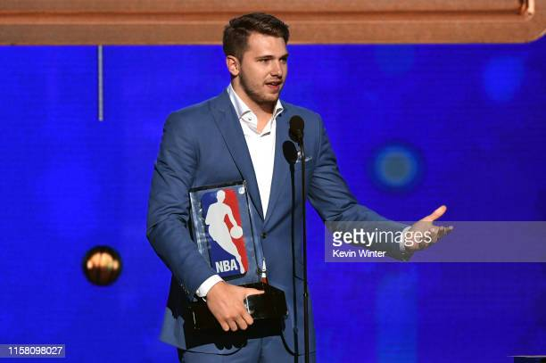 Luka Dončić accepts the Kia NBA Rookie of the Year award onstage during the 2019 NBA Awards presented by Kia on TNT at Barker Hangar on June 24 2019...