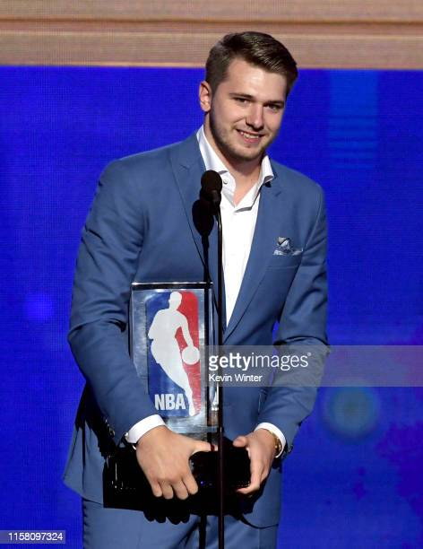 Luka Dončić accepts the Kia NBA Rookie of the Year onstage during the 2019 NBA Awards presented by Kia on TNT at Barker Hangar on June 24 2019 in...