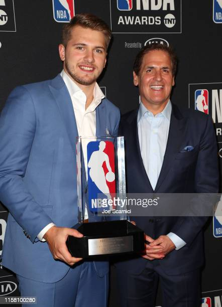 Luka Dončić winner of the Kia NBA Rookie of the Year award and Mark Cuban pose in the press room during the 2019 NBA Awards presented by Kia on TNT...