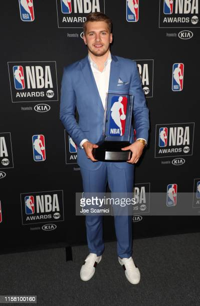 Luka Dončić winner of the Kia NBA Rookie of the Year award poses in the press room during the 2019 NBA Awards presented by Kia on TNT at Barker...