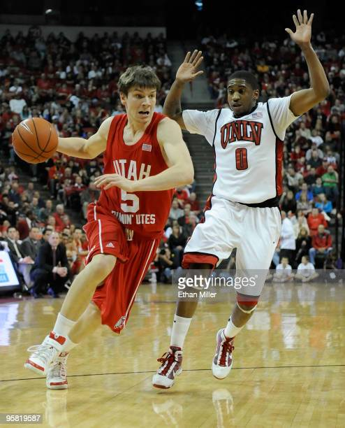 Luka Drca of the Utah Utes drives against Oscar Bellfield of the UNLV Rebels during their game at the Thomas Mack Center January 16 2010 in Las Vegas...