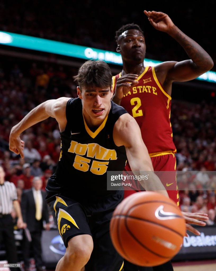 Luka Garza #55 of the Iowa Hawkeyes battles for a rebound with Cameron Lard #2 of the Iowa State Cyclones in the second half of play at Hilton Coliseum on December 7, 2017 in Ames, Iowa. The Iowa State Cyclones won 84-78 over the Iowa Hawkeyes.