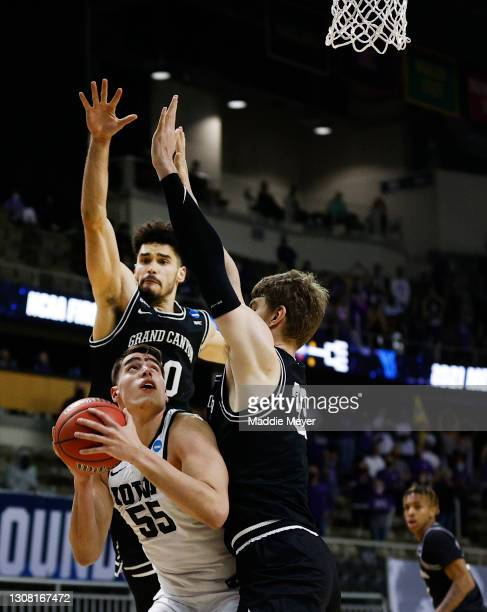Luka Garza of the Iowa Hawkeyes drives to the basket as Gabe McGlothan of the Grand Canyon Antelopes and Asbjorn Midtgaard of the Grand Canyon...