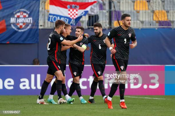 Luka Ivanusec of Croatia celebrates with team mates after scoring their side's first goal during the 2021 UEFA European Under-21 Championship...