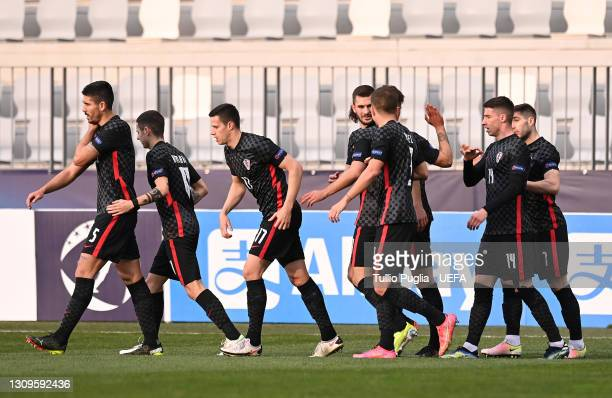 Luka Ivanusec of Croatia celebrates with teammates after scoring their team's first goal during the 2021 UEFA European Under-21 Championship Group D...