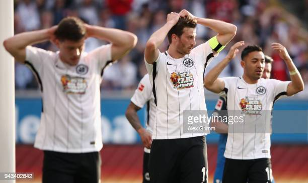 Luka Jovic David Abraham and Marco Fabian of Frankfurt react during the Bundesliga match between Eintracht Frankfurt and TSG 1899 Hoffenheim at...