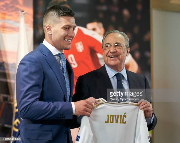 Luka Jovic is presented as new player of Real Madrid CF Presidenta and player pose with the Jerseyat Estadio Santiago Bernabeu on June 12 2019 in...