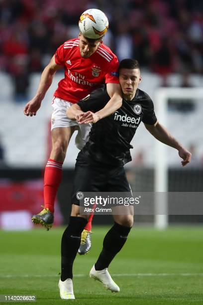 Luka Jovic of Eintracht Frankfurt and Ruben Dias of Benfica competes for a header during the UEFA Europa League Quarter Final First Leg match between...