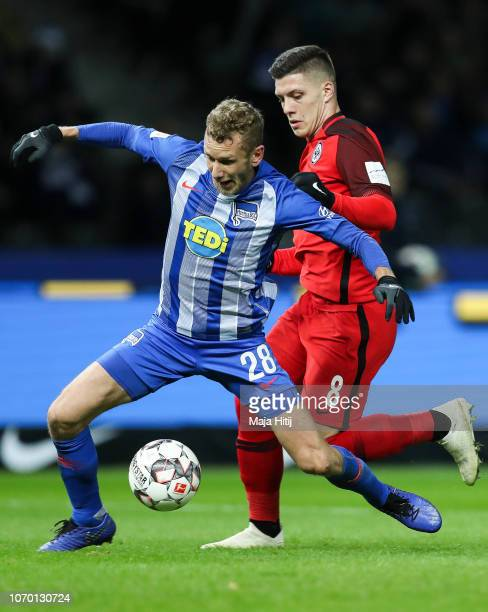 Luka Jovic of Eintracht Frankfurt battles for possession with Fabian Lustenberger of Hertha Berlin during the Bundesliga match between Hertha BSC and...