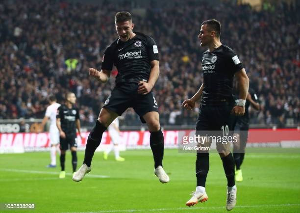 Luka Jovic of Eintracht Frankfurt celebrates after scoring his team's second goal with Filip Kostic of Eintracht Frankfurt during the Bundesliga...