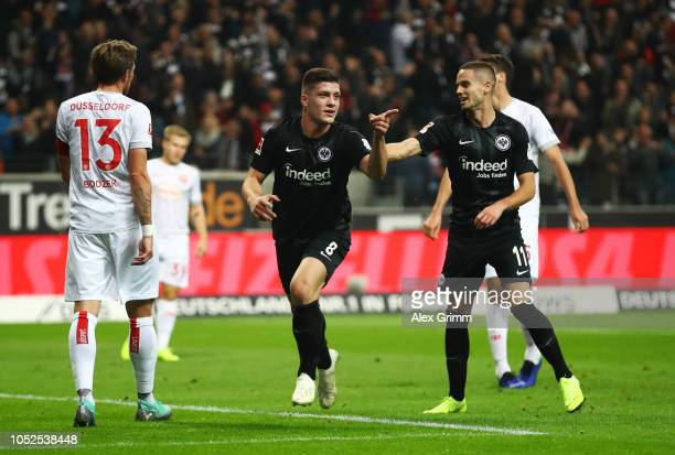 Luka Jovic of Eintracht Frankfurt celebrates after scoring his team's second goal with Mijat Gacinovic of Eintracht Frankfurt during the Bundesliga...