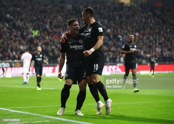 Luka Jovic of Eintracht Frankfurt celebrates after scoring his team's second goal with Filip Kostic of Eintracht Frankfurt during the Bundesliga...