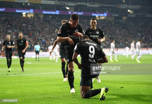 Luka Jovic of Eintracht Frankfurt celebrates after scoring his team's third goal with Sebastien Haller of Eintracht Frankfurt during the Bundesliga...