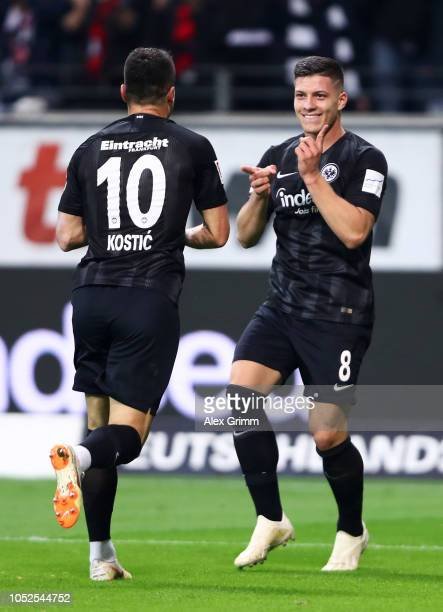 Luka Jovic of Eintracht Frankfurt celebrates after scoring his team's fifth goal and completes his hat trick with Filip Kostic of Eintracht Frankfurt...