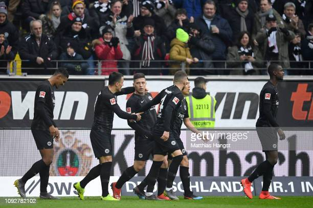 Luka Jovic of Eintracht Frankfurt celebrates after scoring his team's first goal with his team mates during the Bundesliga match between Eintracht...