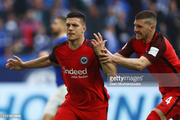 Luka Jovic of Eintracht Frankfurt celebrates scoring his teams second goal of the game from the penalty spot in the final seconds with team mate Ante...