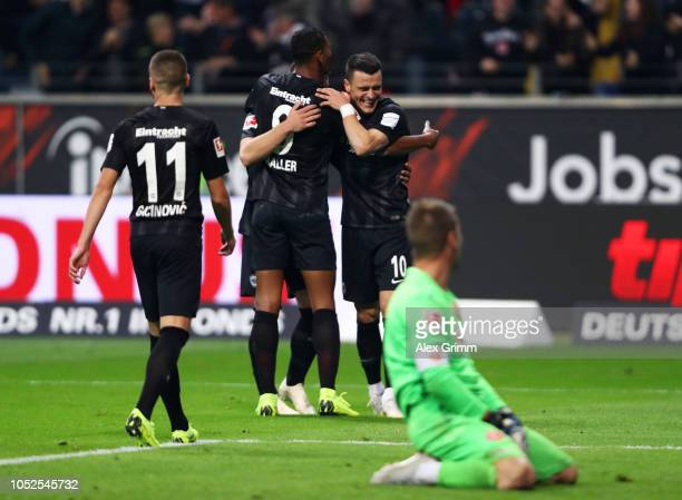 Luka Jovic of Eintracht Frankfurt celebrates with team mates after scoring his team's sixth goal and his fourth during the Bundesliga match between...
