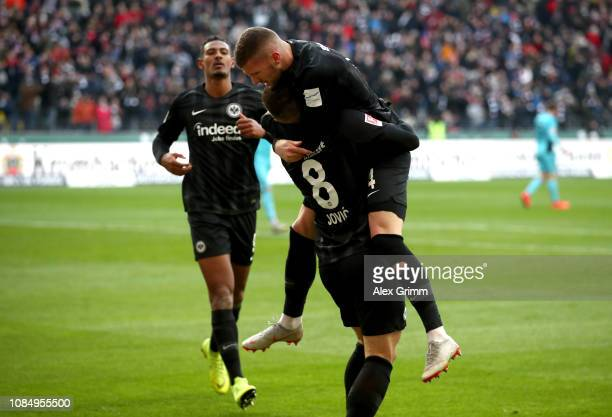 Luka Jovic of Eintracht Frankfurt celebrates with teammates after scoring his sides third goal during the Bundesliga match between Eintracht...