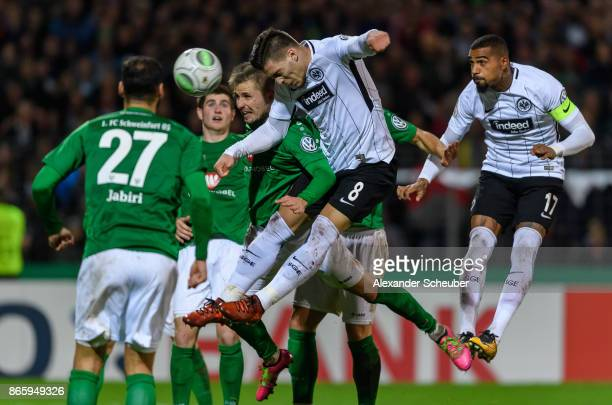 Luka Jovic of Eintracht Frankfurt in action against Christopher Kracun of Schweinfurt during the DFB Cup match between 1 FC Schweinfurt 1905 and...