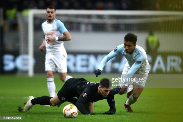 Luka Jovic of Eintracht Frankfurt is challenged by Boubacar Kamara of Marseille during the UEFA Europa League Group H match between Eintracht...