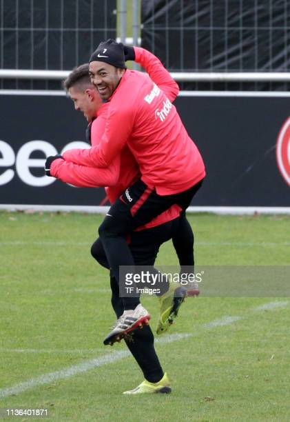Luka Jovic of Eintracht Frankfurt jokes around with Marco Fabian of Eintracht Frankfurt during a training session of Eintracht Frankfurt at...