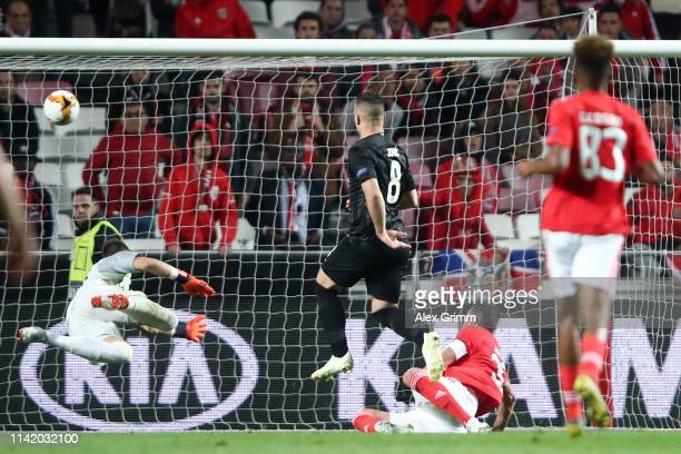 Luka Jovic of Eintracht Frankfurt scores his team's first goal past Odisseas Vlachodimos of Benfica during the UEFA Europa League Quarter Final First...