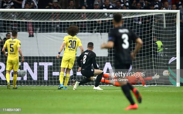 Luka Jovic of Eintracht Frankfurt scores his team's first goal past Kepa Arrizabalaga of Chelsea during the UEFA Europa League Semi Final First Leg...