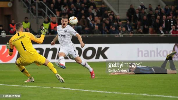 Luka Jovic of Eintracht Frankfurt scores the opening goal past Samir Handanovic of FC Internazionale during the UEFA Europa League Round of 16 Second...