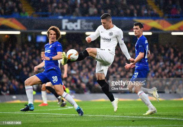 Luka Jovic of Eintracht Frankfurt stretches for the ball under pressure from David Luiz and Andreas Christiansen of Chelsea during the UEFA Europa...