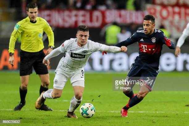 Luka Jovic of Frankfurt and Corentin Tolisso of Muenchen battle for the ball during the Bundesliga match between Eintracht Frankfurt and FC Bayern...