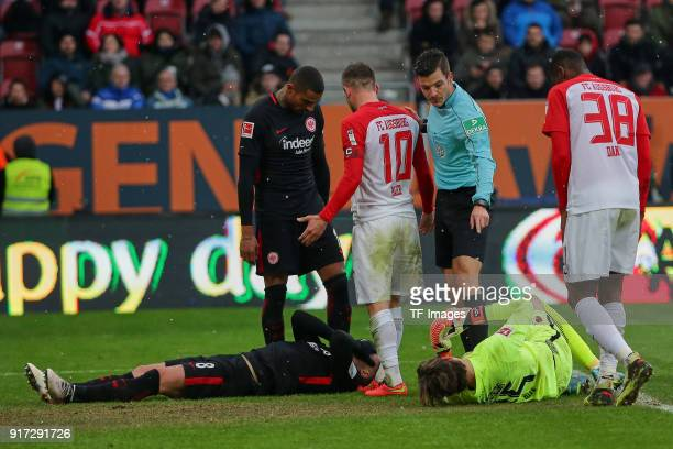 Luka Jovic of Frankfurt and Goalkeeper Marvin Hitz of Augsburg lay on the ground and KevinPrince Boateng of Frankfurt Daniel Baier of Augsburg...