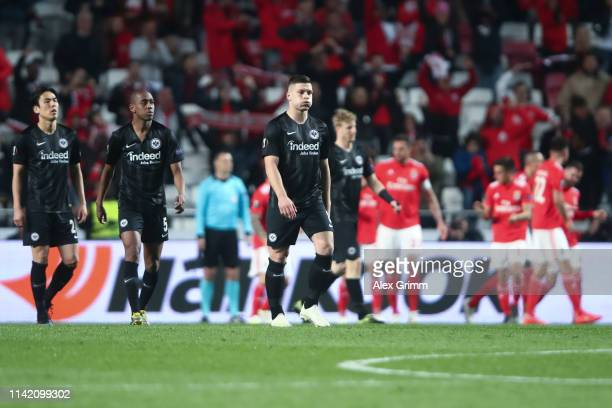 Luka Jovic of Frankfurt and team mates react after Joao Felix of Benfica scored his team's fourth goal during the UEFA Europa League Quarter Final...