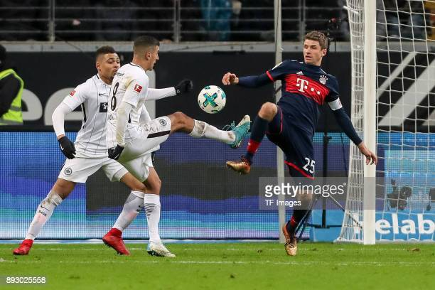 Luka Jovic of Frankfurt and Thomas Mueller of Muenchen battle for the ball during the Bundesliga match between Eintracht Frankfurt and FC Bayern...
