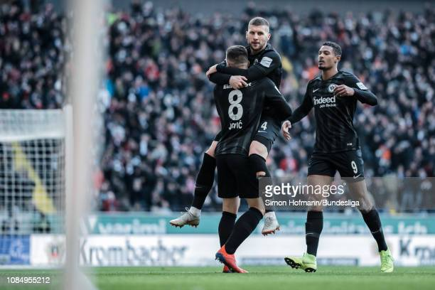 Luka Jovic of Frankfurt celebrates a goal with team mates Ante Rebic and Sebastien Haller during the Bundesliga match between Eintracht Frankfurt and...
