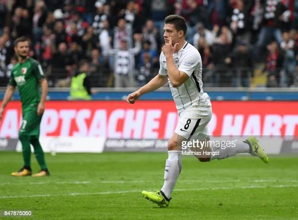 Luka Jovic of Frankfurt celebrates after scoring his team's first goal during the Bundesliga match between Eintracht Frankfurt and FC Augsburg at...