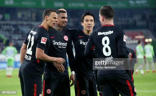 Luka Jovic of Frankfurt celebrates after scoring his team's third goal with Makoto Hasebe KevinPrince Boateng and Timothy Chandler of Frankfurt...