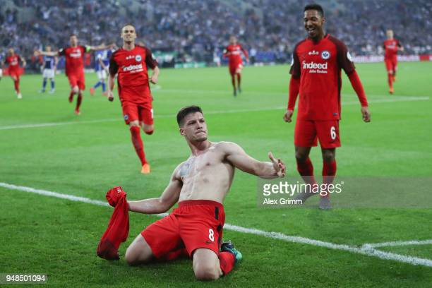 Luka Jovic of Frankfurt celebrates his team's first goal with team mates during the DFB Cup Semi Final match between FC Schalke 04 and Eintracht...