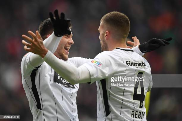 Luka Jovic of Frankfurt celebrates with Ante Rebic of Frankfurt after he scored a goal to make it 2:0 during the Bundesliga match between Eintracht...
