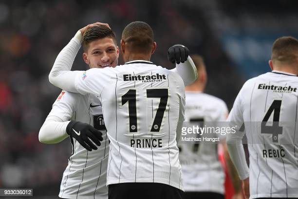 Luka Jovic of Frankfurt celebrates with Kevin PrinceBoateng of Frankfurt after he scored a goal to make it 20 during the Bundesliga match between...
