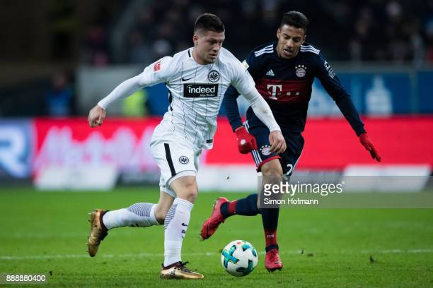 Luka Jovic of Frankfurt is challenged by Corentin Tolisso of Muenchen during the Bundesliga match between Eintracht Frankfurt and FC Bayern Muenchen...