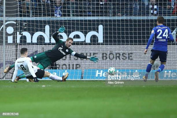 Luka Jovic of Frankfurt scores a goal past goalkeeper Ralf Faehrmann of Schalke to make it 10 during the Bundesliga match between Eintracht Frankfurt...