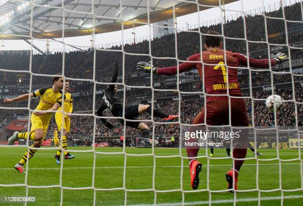 Luka Jovic of Frankfurt scores his team's first goal during the Bundesliga match between Eintracht Frankfurt and Borussia Dortmund at...