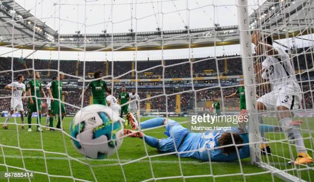 Luka Jovic of Frankfurt scores his team's first goal past goalkeeper Marwin Hitz of Augsburg during the Bundesliga match between Eintracht Frankfurt...