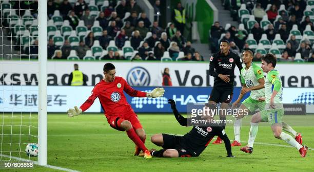 Luka Jovic of Frankfurt scores his team's third goal against goalkeeper Koen Casteels of Wolfsburg during the Bundesliga match between VfL Wolfsburg...