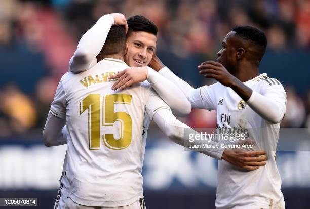 Luka Jovic of Real Madrid celebrates with Federico Valverde and Vinicius Junior after scoring his team's fourth goal during the La Liga match between...
